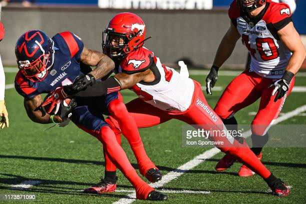 Montreal Alouettes wide receiver Quan Bray gets tackled during the Calgary Stampeders versus the Montreal Canadiens game on October 05 at Percival...