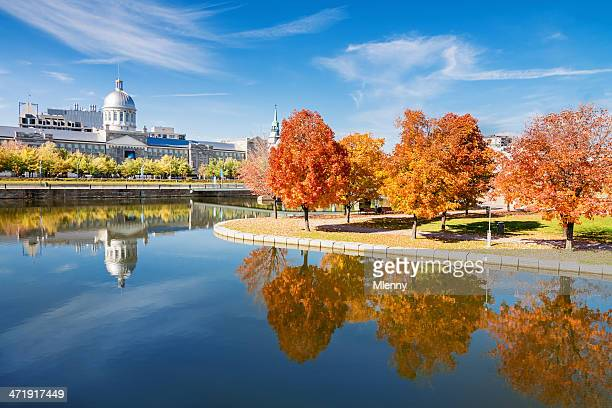 Old Montreal Bonsecours Market and beautifully colored autumn trees reflecting in the water.