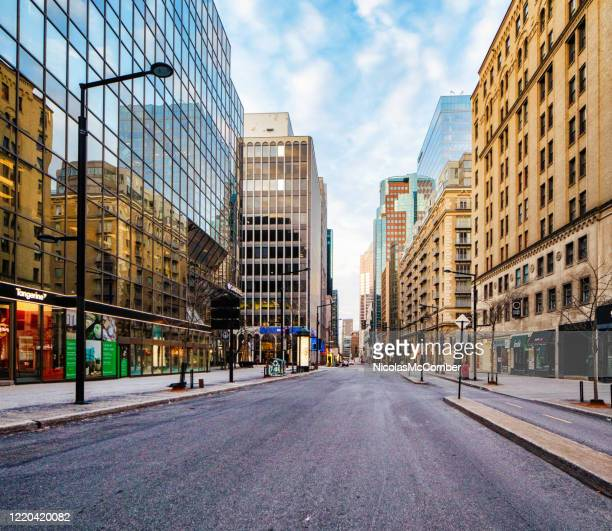 montreal boulevard de maisonneuve at sunset on an april cloudy day - downtown stock pictures, royalty-free photos & images