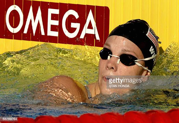 Amanda Weir of the USA looks at the clock after swimming in the Women's 100M Freestyle semifinal 28 July 2005 at the XI FINA Swimming World...