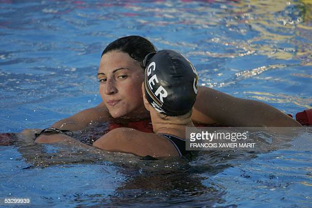 Anne Poleska of Germany embraces Mirna Jukic of Austria after swimming in the Women's 200M Breaststroke semifinal 28 July 2005 at the XI FINA...