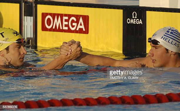 Aristeidis Grigoriadis of Greece shakes hands with Andrew Lauterstein of Australia after the Men's 100M Backstroke semifinal 25 July 2005 at the XI...