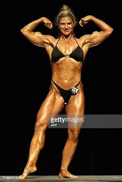 Bernadette Buyer flexes her muscles 02 August 2006 at the women's bodybuilding competition of the first World OutGames in Montreal Canada The...