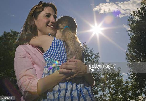 Canadian mother Melanie Boivin hugs her 7-year-old daughter, 02 July 2007 in Montreal, Quebec, Canada. Melanie has had some of her eggs frozen that...