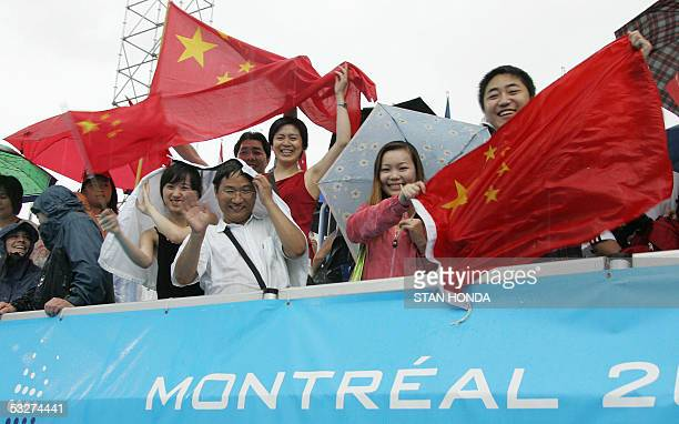 Chinese fans celebrate the first and second place finish of their divers Jingjing Guo and Xia Min Wu 22 July 2005 at the XI FINA Swimming World...