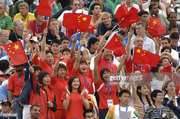 Chinese fans cheer their support for Wu Peng in the Men's 200M Butterfly semifinal 26 July 2005 at the XI FINA Swimming World Championships at Parc...