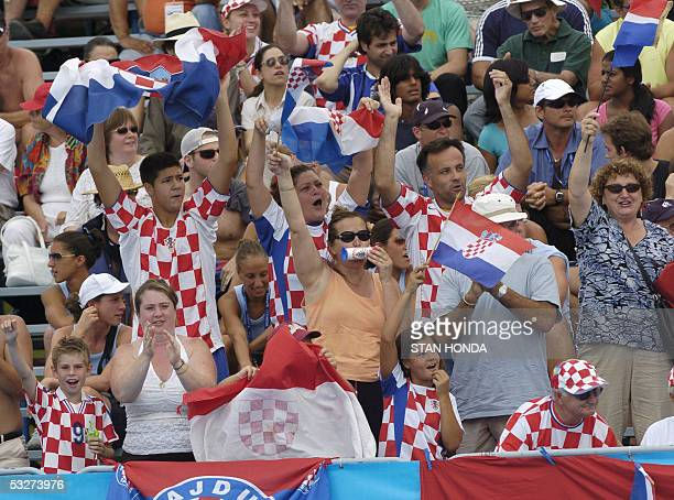 Croatian fans cheer on their team during Croatia's Men's preliminary Water Polo match against Hungary 22 July 2005 at the XI FINA Swimming World...
