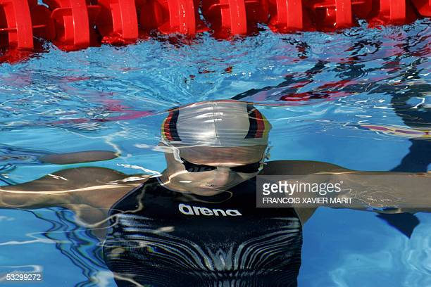 Daniela Gotz of Germany ducks under water after swimming in the Women's 100M Freestyle semifinal 28 July 2005 at the XI FINA Swimming World...