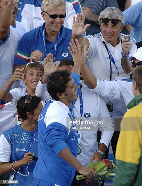 Filippo Magnini of Italy receives accolades from the crowd after the Men's 100M Freestyle final 28 July 2005 at the XI FINA Swimming World...