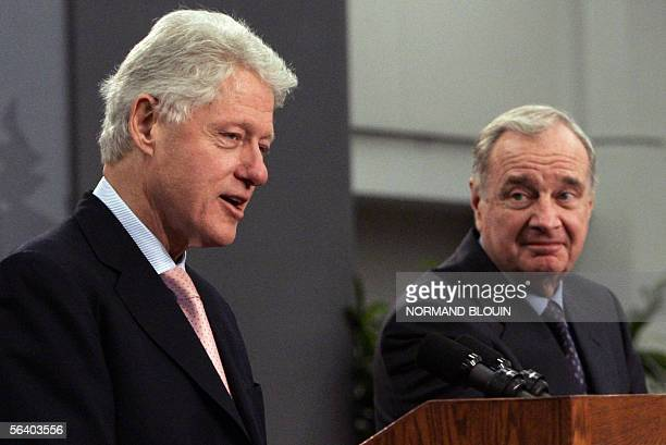 Former US president Bill Clinton addresses a press conference with Canadian Prime Minister Paul Martin at the United Nations Framework Convention on...