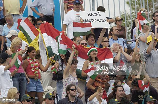 Hungarian fans shout encouragement to their team during Hungary's Men's preliminary Water Polo match against Croatia 22 July 2005 at the XI FINA...