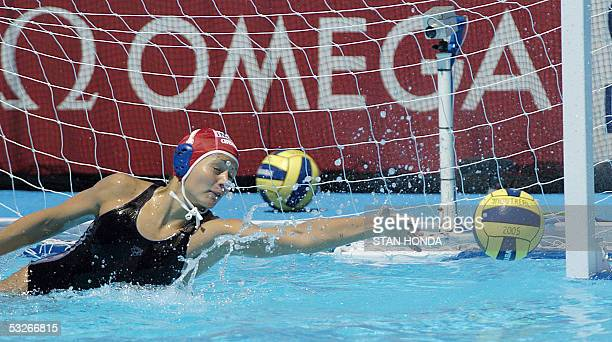 Hungary's goalkeeper Patricia Horvath stretches to block a shot by a Spainish player during a Women's preliminary Water Polo match 21 July 2005 at...
