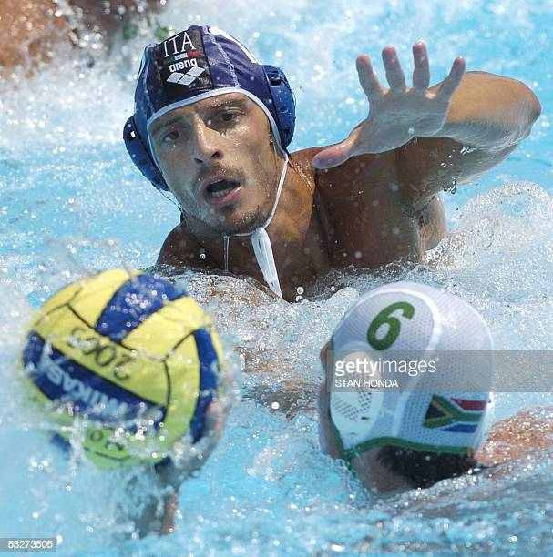 Italy's Alessandro Calcaterra challenges Alastair Stewart of the Republic of South Africa for the ball during their Men's preliminary Water Polo...