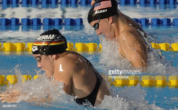 Jessica Hardy of the USA and Sarah Poewe of Germany swim the Women's 100M Breaststroke semifinal 25 July 2005 at the XI FINA Swimming World...
