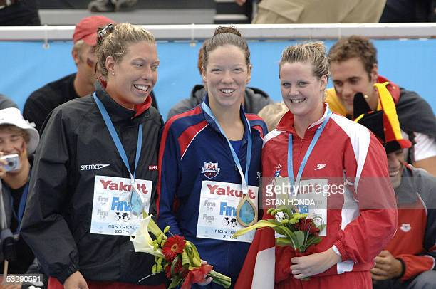 Kate Ziegler of the USA stands with Flavia Rigamonti of Switzerland and Brittany Reimer of Canada during the medals ceremony following the Women's...