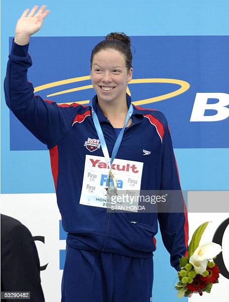 Kate Ziegler of the USA waves during the medals ceremony following the Women's 1500M Freestyle final 26 July 2005 at the XI FINA Swimming World...
