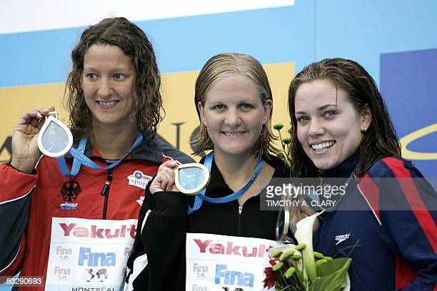 Kirsty Coventry of Zimbabwe stands with Antje Buschschulte of Germany and Natalie Coughlin of the USA on the medals podium following the Women's 100M...