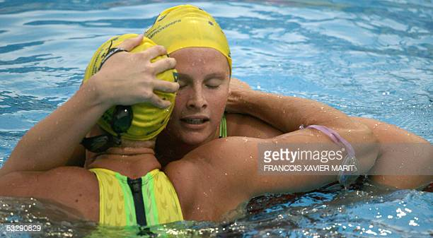 Leisel Jones of Australia is embraced by an unidentified competitor after the Women's 100M Breaststroke final 26 July 2005 at the XI FINA Swimming...