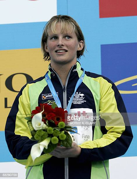 Leisel Jones of Australia stands on the medals podium following the Women's 100M Breaststroke final 26 July 2005 at the XI FINA Swimming World...