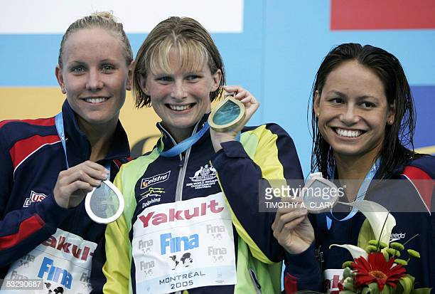 Leisel Jones of Australia stands with Tara Kirk of the USA and Jessica Hardy of the USA on the medals podium following the Women's 100M Breaststroke...