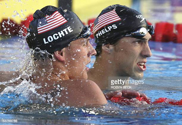 Michael Phelps of the USA and teammate Ryan Lochte check the clock after swimming in the Men's 200M Individual Medley final 28 July 2005 at the XI...