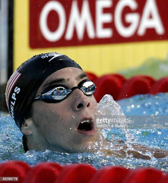 Michael Phelps of the USA checks the clock after swimming in the Men's 200M Individual Medley final 28 July 2005 at the XI FINA Swimming World...