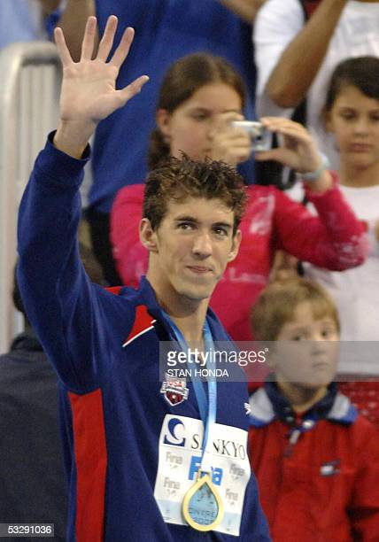 Michael Phelps of the USA waves from the medals podium after the Men's 200M Freestyle final 26 July 2005 at the XI FINA Swimming World Championships...