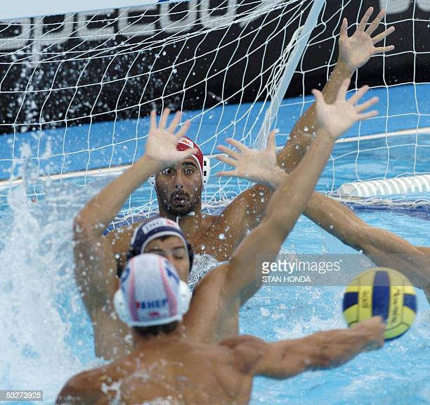 Miho Boskovic of Croatia tries to get a shot on goal through Hungarian defenders during their Men's preliminary Water Polo match 22 July 2005 at the...