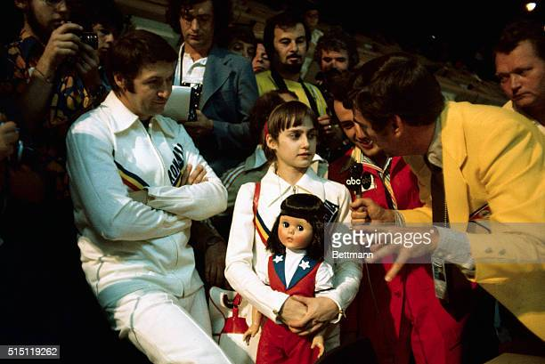 Nadia Comaneci holds onto her doll tightly after the 14yearold superstar captured a gold medal and the hearts of the spectators for her Olympic...