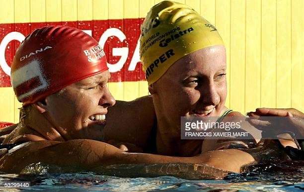 Otylia Jedrzejczak of Poland is congratulated by Jessicah Schipper of Australia after the Women's 200M Butterfly final 28 July 2005 at the XI FINA...