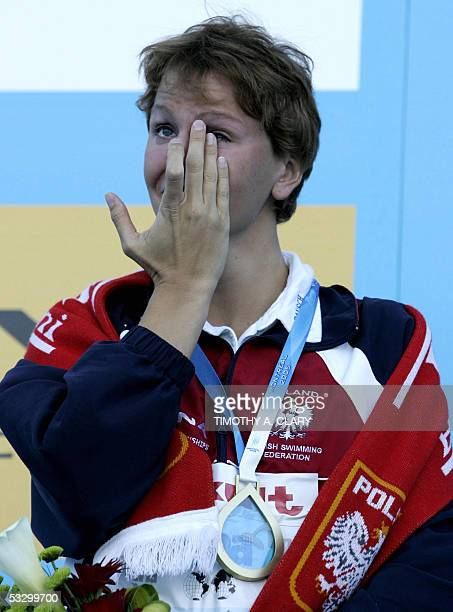 Otylia Jedrzejczak of Poland wipes her eyes during the medals ceremony following the Women's 200M Butterfly final 28 July 2005 at the XI FINA...