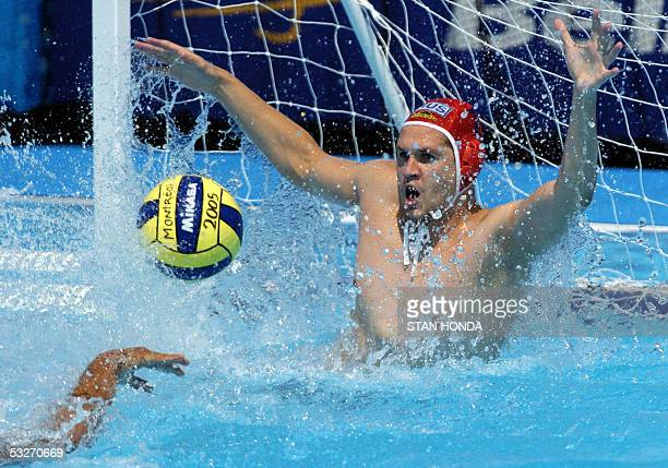 Russia's goalkeeper Alexander Federov attempts to block a shot by Spain's Gabriel Hernandezduring their Men's preliminary Water Polo match 22 July...
