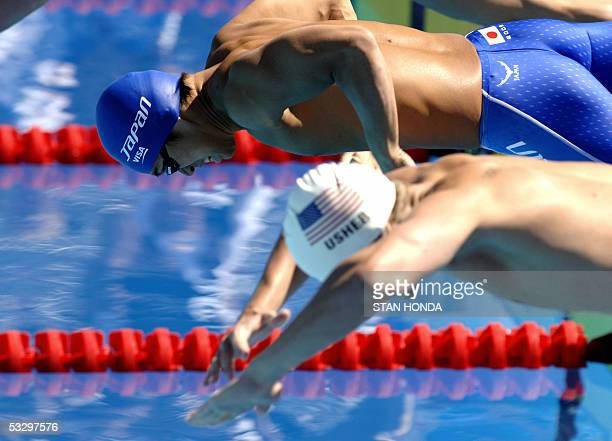 Scott Usher of the USA and Genki Imamura of Japan dive at the start of their heat of the Men's 200M Breaststroke 28 July 2005 at the XI FINA Swimming...