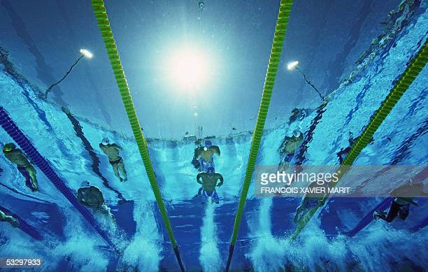 Swimmers participate in a heat of the Men's 200M Breaststroke 28 July 2005 at the XI FINA Swimming World Championships at Parc JeanDrapeau in...