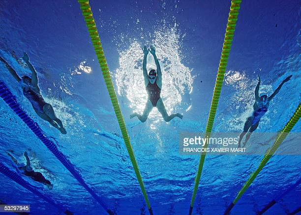 Swimmers participate in a heat of the Women's 200M Breaststroke 28 July 2005 at the XI FINA Swimming World Championships at Parc JeanDrapeau in...