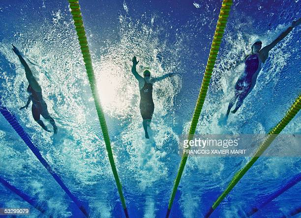 Swimmers participate in a preliminary heat of the Women's 100M Freestyle 28 July 2005 at the XI FINA Swimming World Championships at Parc JeanDrapeau...