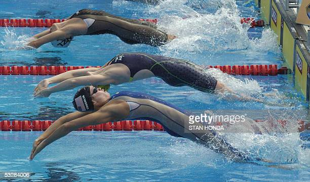 Swimmers start a heat in the Women's 100M Backstroke semifinal 25 July 2005 at the XI FINA Swimming World Championships at Parc JeanDrapeau in...