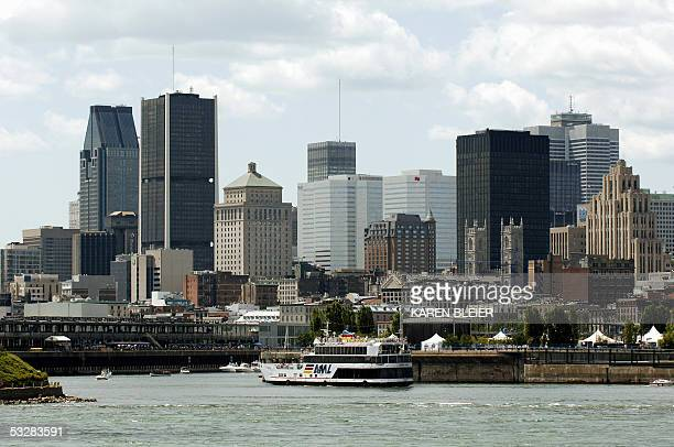 The skyline of Montreal Canada 23 July 2005 is shown from Parc JeanDrapeau AFP PHOTO/Karen BLEIER