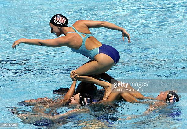 The United States synchronized swimming team practice their routine 15 July 2005 in preparation for the 2005 XI FINA World Championships that will...