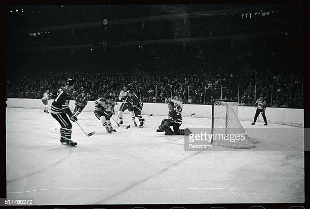 Montreal Canadians Yvan Cournoyer skates in attempting to score past Chicago Black Hawks goaling of Denis Dejordy who made save in 1st period of game