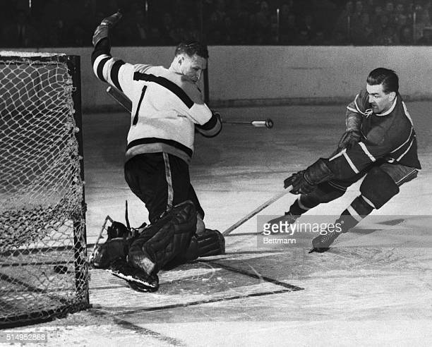 Montreal Canadien Maurice Richard scores on the Boston Bruin goalie Red Henry during the first period of the Montreal Canadiens-Boston Bruins game....