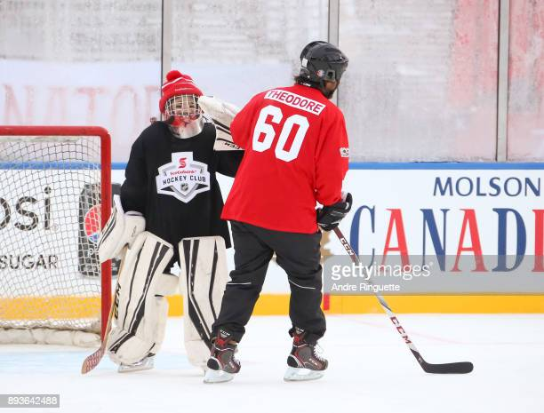 Montreal Canadiens alumni José Théodore high fives a Scotiabank skater to celebrate the sponsorship of 1 million minor hockey league kids in advance...