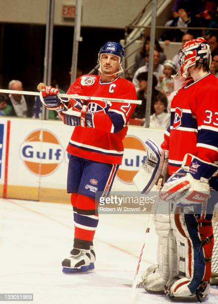 Montreal Canadiens captain Guy Carbonneau talks with Patrick Roy during game vs Hartford Whalers Hartford CT 1992