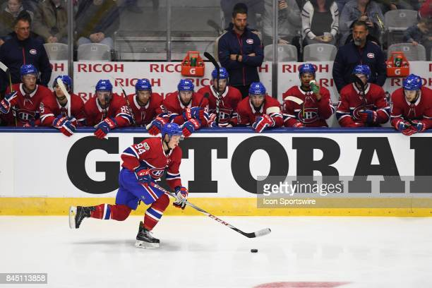 Montreal Canadiens center James McEwan skates with the puck during the third period of the NHL rookie tournament game between the Montreal Canadiens...
