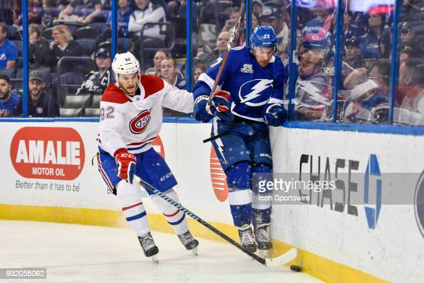 Montreal Canadiens center Jonathan Drouin and Tampa Bay Lightning defender Ryan McDonagh battle for a puck during the third period of an NHL game...