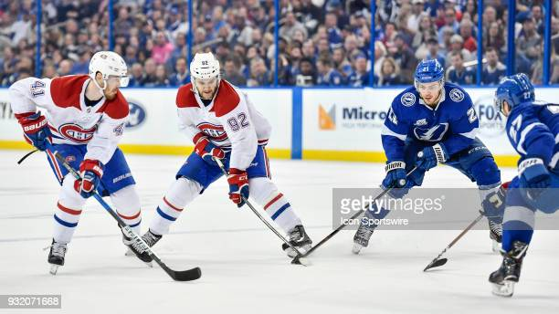 Montreal Canadiens center Jonathan Drouin and Tampa Bay Lightning center Brayden Point battle for a puck during the third period of an NHL game...