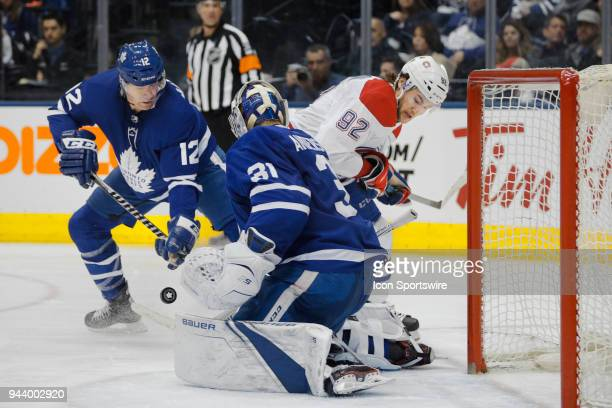 Montreal Canadiens Center Jonathan Drouin drives the puck to the net as Toronto Maple Leafs Left Wing Patrick Marleau assists teammate Goalie...