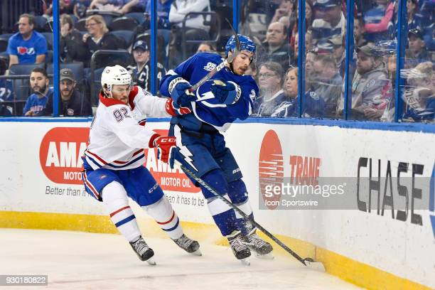 Montreal Canadiens center Jonathan Drouin poke checks Tampa Bay Lightning defender Ryan McDonagh during the third period of an NHL game between the...