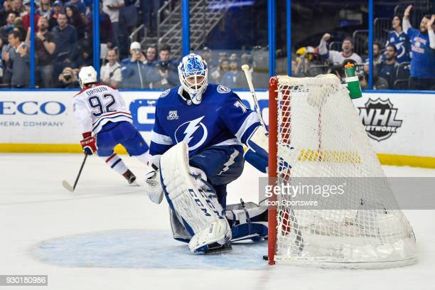 Montreal Canadiens center Jonathan Drouin skates away after scoring in the shootout as Tampa Bay Lightning goalie Louis Domingue collects the puck...
