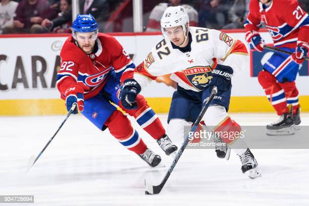 Montreal Canadiens center Jonathan Drouin tries to take the puck away from Florida Panthers center Denis Malgin during the first period of the NHL...